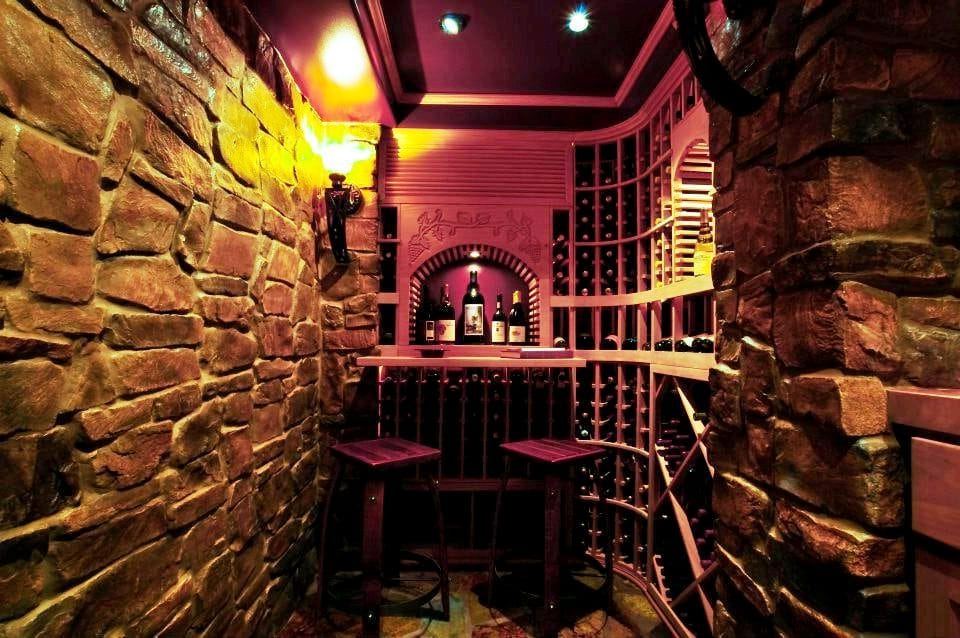 A Stunning and Climate-Controlled Custom Home Wine Cellar Increases the Resale Value of a Home