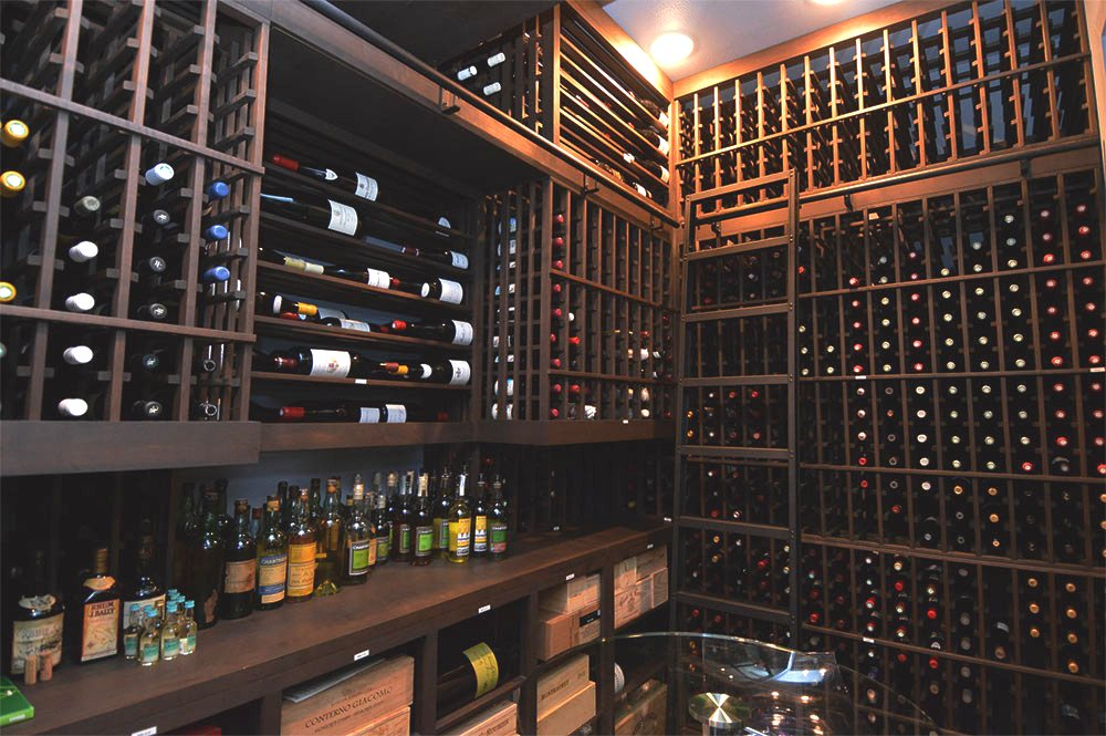 Custom Wooden Wine Cellar with installed ladder and railing